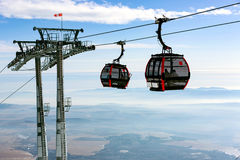 Cabins of ski lift in air Royalty Free Stock Image