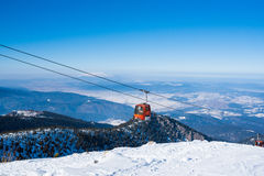 Cabins of ski lift on winter mountain resort Stock Images