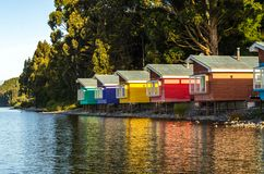 Cabins type palafito in Puerto Varas. View of the Llanquihue lake with colorful stilt houses surrounded by a typical forest of the Chilean Araucanía stock photo