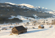 Cabins in valley with mountain tops Stock Images