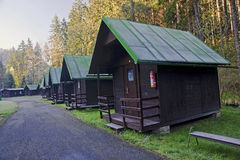 Cabins in the woods along the road Royalty Free Stock Photo