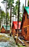 Cabins in the woods Stock Photography