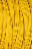 Cable óptico amarillo Fotos de archivo libres de regalías