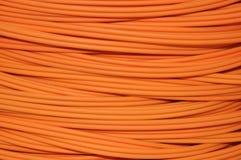 Cable óptico anaranjado Foto de archivo libre de regalías