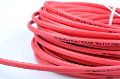 CABLE. HEATING CABLE, RED CABLE, CORD Stock Image