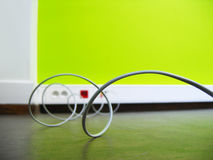 Cable. LAN cable on a green flashy wall royalty free stock image