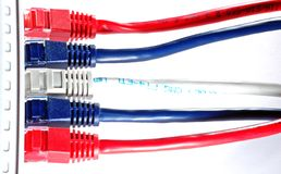 Cable. Network cable in red blue and white plugged into a router stock photos