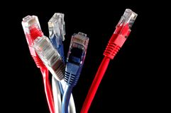 Cable. Network cable in red blue and gray on a black background stock image