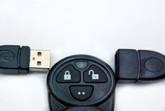Cable. USB cable and remote control for plug and unplug button royalty free stock images