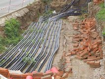 Cable being laid in the city. Telecommunication cables being laid down in the city. The work has lasted so long that the plants found a new place to grow in the Royalty Free Stock Photo