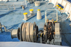 Cable on the blue deck of ship Stock Image