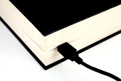 Cable and a book Royalty Free Stock Images