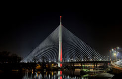 Cable bridge Belgrade at night with city lights. Panorama Most na Adi stock photo