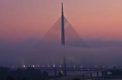 Cable bridge in fog at autumn morning, Belgrade Stock Photos