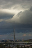 Cable bridge in low dark clouds before a storm in Belgrade Stock Photos