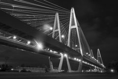 Cable bridge at night (black and white). Black and white version of night panoramic shot of huge a cable bridge Royalty Free Stock Photography