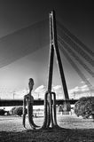 Cable bridge and sculpture in Riga stock photography