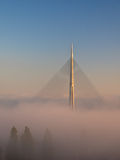 Cable bridge on sunshine above a fog Royalty Free Stock Photos