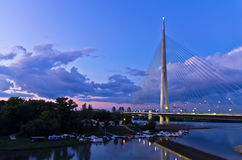 Cable bridge at twilight over Sava river near Ada island Stock Images