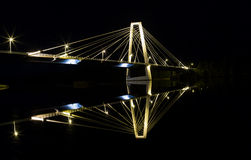 Cable Bridge in Umeå, Sweden. At night being reflected in the river Stock Photography