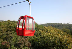 Cable car. Red cable car in badachu park of beijing by pentax Royalty Free Stock Image