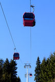 Cable car above trees Royalty Free Stock Photos