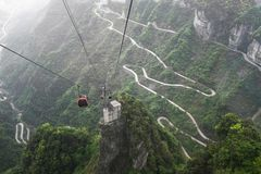Cable car above winding road in Tianmen mountain, China