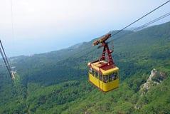 Cable car above a wood. Crimea, mountain ajpetri Stock Photos