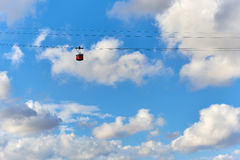 Cable car against blue cloudy sky Stock Images