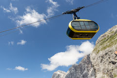 Cable Car Against Blue Sky In Austrian Alps Royalty Free Stock Photo