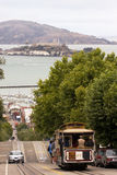 Cable car and Alcatraz Island in San Francisco Stock Photography