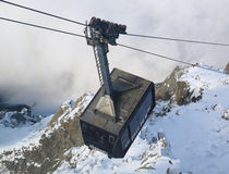 Cable car arriving to Auguille du Midi from Chamonix Royalty Free Stock Photos