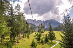 Cable car in Austria heading up. Cable car in Austria heading up in the Alps Stock Image