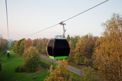 Cable car at autumn park in evening sunset Stock Photo