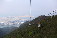 The cable car in the beautiful green mountains, the Bay and the city. Royalty Free Stock Photo