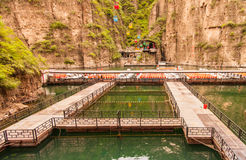 Cable car and boats in LongQing Xia. Royalty Free Stock Photography