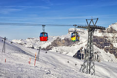 Cable car cabins on the swiss ski resort slope Royalty Free Stock Images
