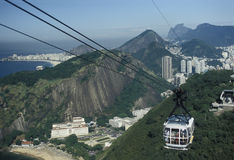 The cable car carrying passengers on top of the Pao de Açucar ( Royalty Free Stock Photo