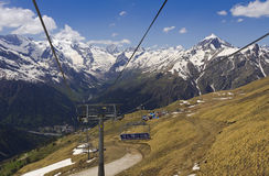 Cable car, chairlift on the mountain Mussa-Achitara.Dombay meadow. Royalty Free Stock Photos