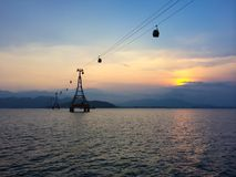 Cable car with cloudy sky on the background at sunset Stock Image