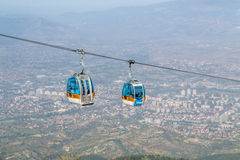 Cable car. Conecting the big city with the natural mountain Stock Images