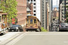 Cable car cresting a hill. Stock Images