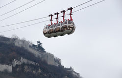 Cable car descending from fortress Stock Photos
