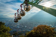 Cable car descending La Bastille in Grenoble. Cable car descending La Bastille hill in Grenoble in France with a nice sunset in the background Royalty Free Stock Photo