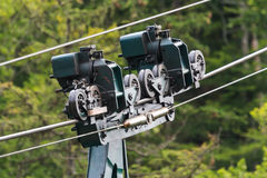 Cable car detail. Detail of the carriage structure of a cable car (aerial tram), with carriage-, pulling rope and support wheels Royalty Free Stock Photography