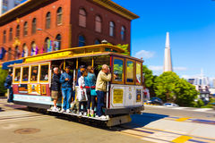 Cable Car Downtown Cityscape San Francisco View H. San Francisco, USA - May 20, 2016: Downtown financial district view behind a cable car rolling past California Stock Photos