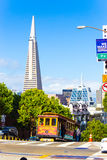 Cable Car Downtown Cityscape San Francisco View V. San Francisco, USA - May 20, 2016: Scenic view of downtown financial district behind a cable car climbing up Stock Photography