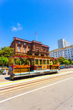 Cable Car Flood Mansion Fairmont California St V. San Francisco, USA - May 20, 2016: Cable car rolling down California Street in front of Flood Mansion and the royalty free stock photos