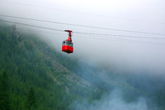 Cable car through fog Royalty Free Stock Photos