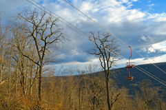 Cable car through the forest on a ridge top. The lift to the vie Royalty Free Stock Image